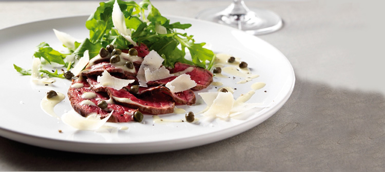 Carpaccio with horseradish dressing,  wild rocket and Parmigiano-Reggiano cheese